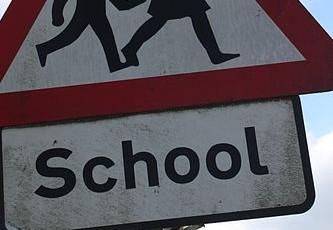 400px-School_sign,_Annacloy,_September_2010
